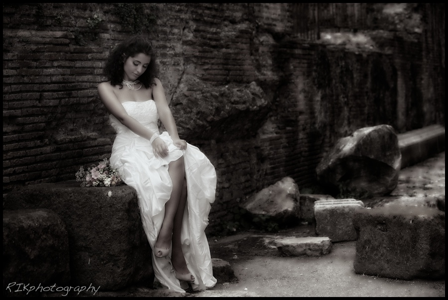 beautiful bride on the ruins of the Parthenon, Rome